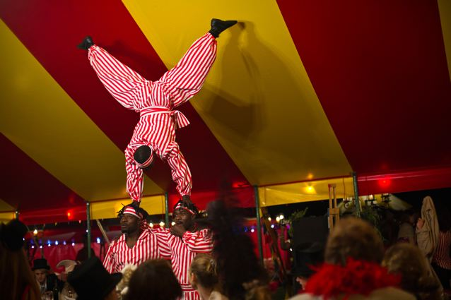 African Acrobats, limbo and bowl spinning acts in circus tent